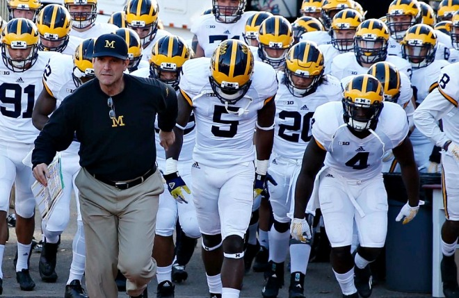 Nov 14, 2015; Bloomington, IN, USA; Michigan Wolverines coach Jim Harbaugh leads his team onto the field before the game against the Indiana Hoosiers  at Memorial Stadium. Mandatory Credit: Brian Spurlock-USA TODAY Sports